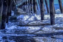 Waves Flowing Below Pier At Be...