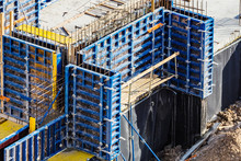 Installed Formworks And Iron Rebars Or Reinforcing Bar For Reinforced Concrete Partitions At The Construction Site Of A Large Residential Building.