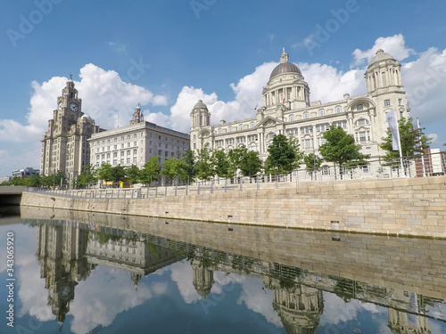Liverpool city waterfront with beautiful architecture. The iconic Liver Birds, Three Graces, cathedrals and other landmarks along the River Mersey and UNESCO World Heritage Site.