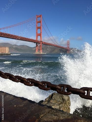 фотография Golden Gate Bridge Over Sea Against Sky