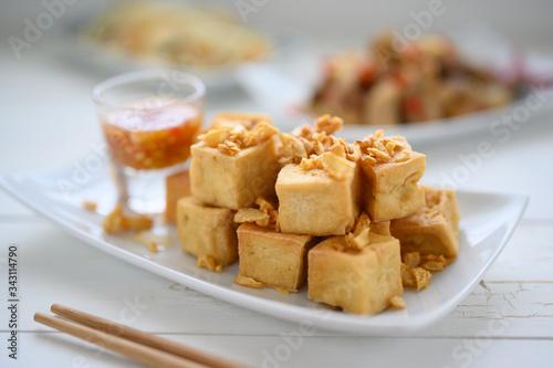 Fototapeta Deep fried tofu is cut into square balls on plate obraz
