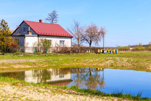 Typical House With Beehives And Small Pond In Rural Area Near Puszcza Niepolomicka Near Krakow City, Poland