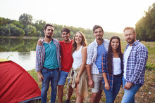 Group Of People Smiling Standing On A Picnic