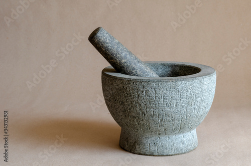 Gray stone mortar with pestle. Canvas Print