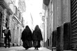 Leinwandbild Motiv Rear View Of Nuns Walking At Street
