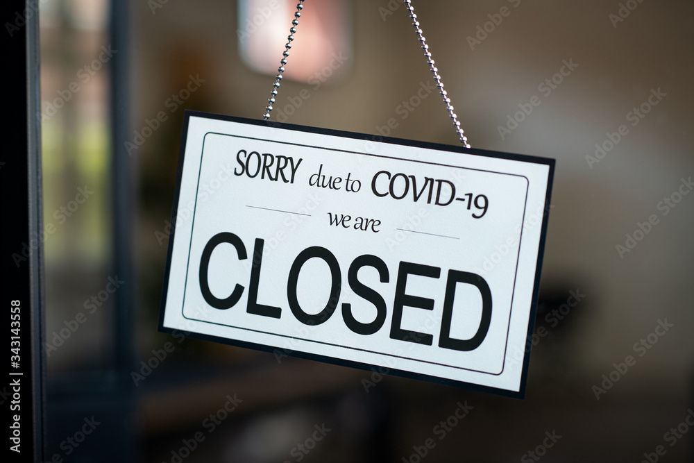Fototapeta Closed sign hanging on door of cafe due to Covid-19