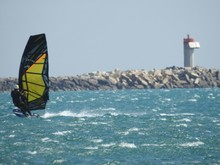 Close-up Of Person Windsurfing On Sea