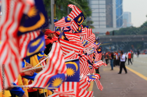 Fotografía Group Of People Holding Malaysian Flag During Parade