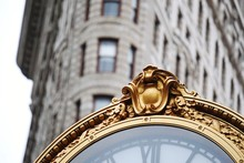 Cropped Clock Against Flatiron Building