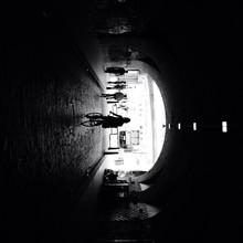 Cyclist Riding Through A Tunnel