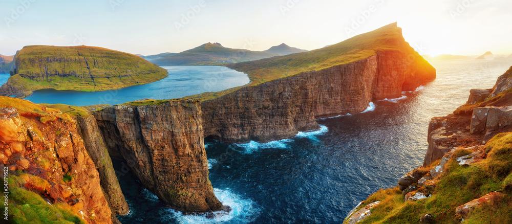 Fototapeta Sorvagsvatn Lake and Waterfall into the Ocean in Western Faroe Island