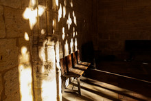 A Wooden Bench Stands In The C...