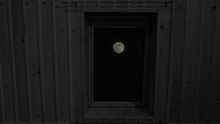 Full Moon Seen Through Window