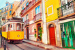 Yellow vintage tram on the street in Lisbon, Portugal. Famous travel destination