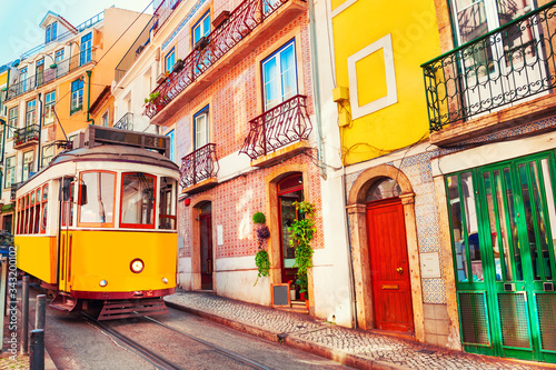 Fotografie, Obraz Yellow vintage tram on the street in Lisbon, Portugal