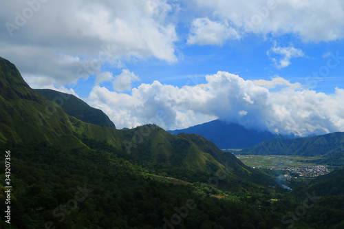 Fototapeta Scenic View Of Green Landscape Against Cloudy Sky obraz na płótnie