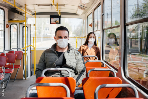 Photo Passengers on public transport during the coronavirus pandemic keep their distance from each other