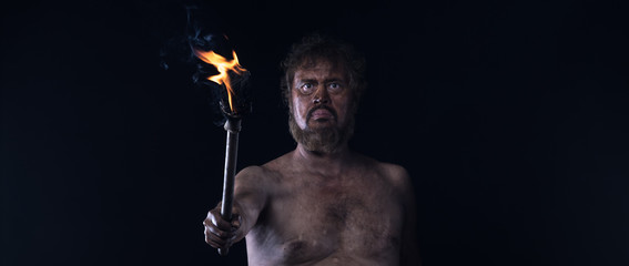 primitive caveman with a torch
