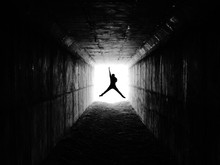 View Of Man Jumping In Excitement In Tunnel