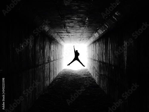 View Of Man Jumping In Excitement In Tunnel - fototapety na wymiar