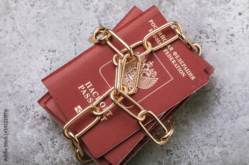 Text in Russian: passport of the Russian Federation. Concept on the prohibition of citizens leaving the country. Identity document wrapped in chain