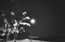 Scenic View Of Beach With Full Moon At Night
