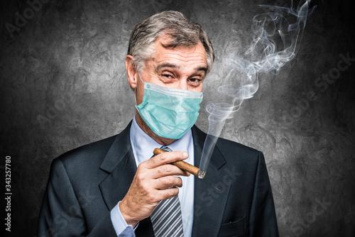 Masked businessman smoking a cigar Canvas-taulu