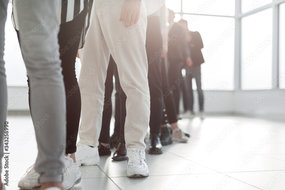 Fototapeta close up. group of young professionals standing in line