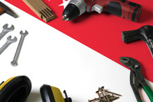 Singapore Flag On Repair Tool Concept Wooden Table Background. Mechanical Service Theme With National Objects.