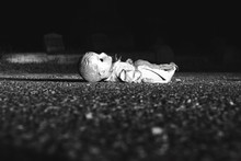 Abandoned Doll On Road At Night