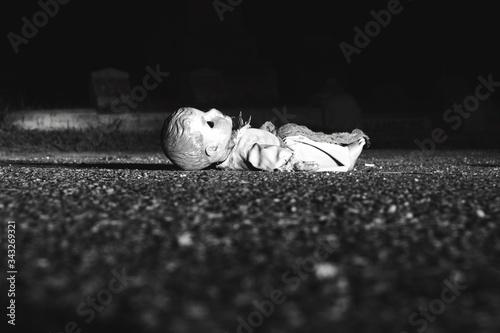 Fotografie, Obraz Abandoned Doll On Road At Night
