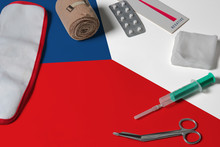 Czech Republic Flag With First Aid Medical Kit On Wooden Table Background. National Healthcare System Concept, Medical Theme.