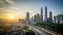 Petronas Towers In City Against Sky During Sunset