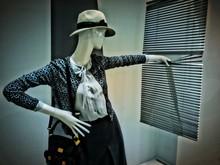 Mannequin Wearing Jacket And Hat With Shoulder Bag Holding Blinds At Shop