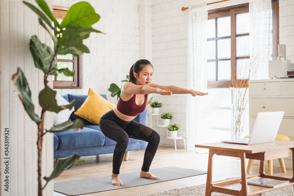 Fototapeta Young Asian healthy woman workout at home, exercise, fit, doing yoga, home fitness concept