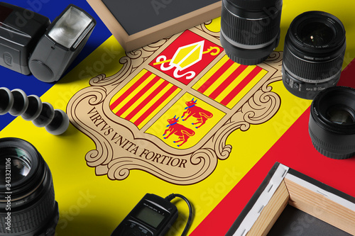 Andorra national flag with top view of personal photographer equipment and tools on white wooden table, copy space Canvas Print