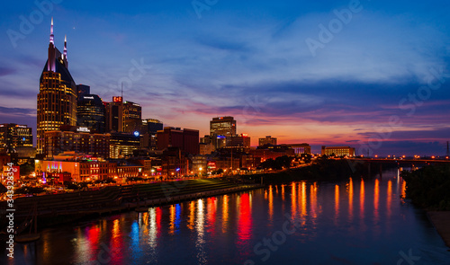 Fototapety, obrazy: Illuminated Buildings By River Against Sky At Night