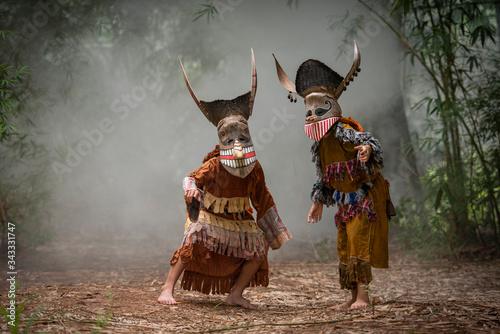 Obraz Phi ta khon festival ghost mask and colorful costume fun traditional thailand mask the show art and culture loei province Dan Sai thailand festival / phi ta khon or halloween of Loei Thailand - fototapety do salonu