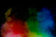 Colorful powder explosion on black background. Colorful dust explode. Paint Holi.