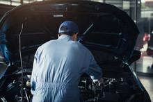 Car Mechanic Opening Car Hood ...