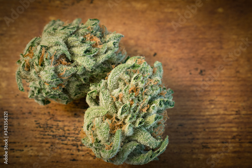 The cannabis strain 'AK-47' on a wooden background. Canvas Print