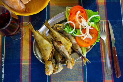 Fotografija Fried fish scad with vegetables. Galician cuisine