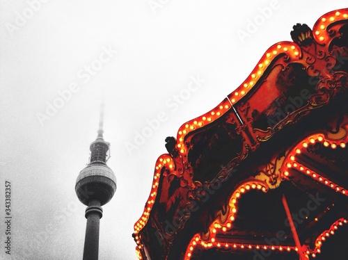 Photo Low Angle View Of Alexanderplatz And Illuminated Carousel Ride