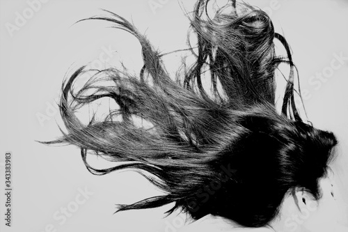 Obraz na plátně Side View Of Woman With Long Black Hair Over White Background