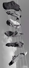 Variety Of Socks Hanging On Washing Line Against Sky