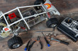 Radio-controlled car model with tools for repairing rc buggy models and control panel.