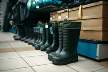 Row Of Rubber Boots In Fishing...