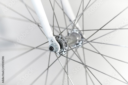 Bicycle wheel closeup front axle hub and fork Canvas Print