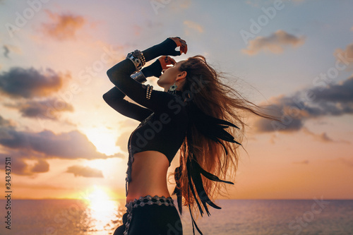 beautiful young tribal style woman on the beach at sunset Wallpaper Mural