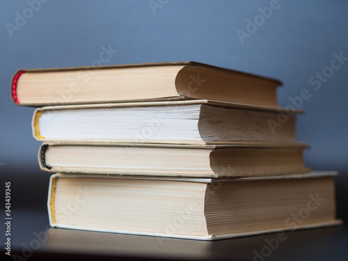 Fotografija stack of hardback books